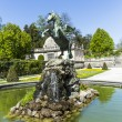 Bronce horse statue in the fountain of the Mirabell Gardens — Stock Photo #76083547