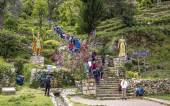 Tourists climb up the old incan steps to the temple in Yimani, — Stok fotoğraf