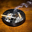 Smoking cigarette in ashtray — Stock Photo #51939459