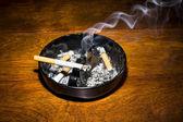 Smoking cigarette in ashtray — Stock Photo