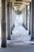 Rough water at beach under pier — Stock Photo
