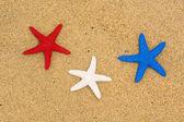 Patriotic starfish on beach — Stock Photo