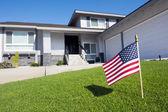 Flag in yard — Stock Photo
