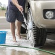 Washing car tires — Stock Photo #64637705