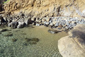Secluded rocky beach — Stock Photo