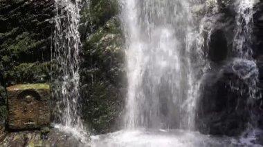 Waterfall with jizo statues — Stock Video