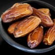 Dried Dates in Black Bowl — Stock Photo #52069425