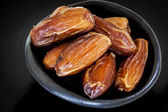 Dried Dates in Black Bowl — Stock Photo