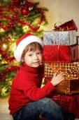 Happy boy with christmas gift near Christmas tree — Stock Photo