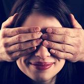 Girl has closed eyes  hands man — Stock Photo