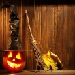 Jack o lanterns  Halloween pumpkin face on wooden background — Stock Photo #54653777