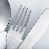 Silverware  on white table  — Stock Photo