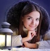 Beautiful girl on winter snow — Stockfoto
