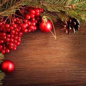 Christmas tree ornaments and viburnum berries — Stock Photo