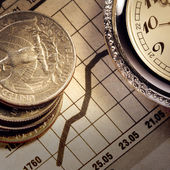 Coin and clock on chart — Stock Photo