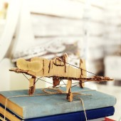Model paper airplane on book — Stock Photo
