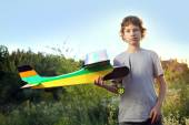 Teen with homemade radio-controlled model aircraft — Stock Photo