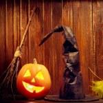 Jack o lanterns  Halloween pumpkin face on wooden background — Stock Photo #77192541