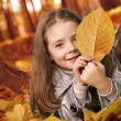 Happy girl in autumn park — Stock Photo #79711932