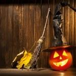 Jack o lanterns Halloween pumpkin face on wooden background — Stock Photo #79713258