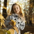 Happy girl in leaves autumn — Photo #80410226