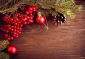 Christmas tree ornaments and viburnum berries — Stock Photo