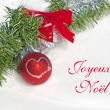 Red Christmas ball ornament with a heart and text Joyeux Noel, Merry Christmas in French — Stock Photo #64325225