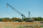 Heavy equipment at a road contruction site — Stock Photo