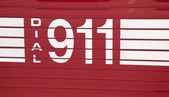 Dial 911 - decal on side of a fire truck — Stockfoto