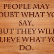People may doubt what you say, but they will believe what you do - motivational quote on wooden red oak background — Stock Photo #71279121