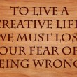 To live a creative life, we must lose our fear of being wrong - quote on wooden red oak background — Stock Photo #71279815