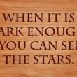When it is dark enough, you can see the stars. - quote on wooden red oak background — Stock Photo #71279937