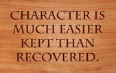Character is much easier kept than recovered - quote on wooden red oak background — Stock Photo