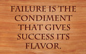 Failure is the condiment that gives success its flavor - quote on wooden red oak background — Stock Photo