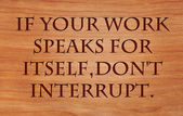 If your work speaks for itself, don't interrupt - a quote on wooden red oak background — Stock Photo