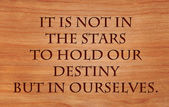 It is not in the stars to hold our destiny but in ourselves - quote by on wooden red oak background — Foto de Stock