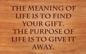 The meaning of life is to find your gift. The purpose of life is to give it away - quote by unknown author on wooden red — Stock Photo
