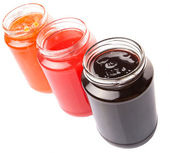 Blueberry, Strawberry And Orange Fruit Open Lid Bottled Jam — Stock Photo