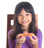 Young Girl Eating Bread — Stock Photo