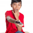 Young Asian Girl With TV Remote Device — Stock Photo #54328053
