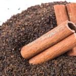 Cinnamon Stick On Dried Tea Leaves — Stock Photo #56726297