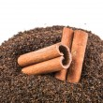 Cinnamon Stick On Dried Tea Leaves — Stock Photo #56726391