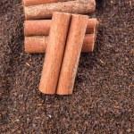 Cinnamon Stick On Dried Tea Leaves — Stock Photo #56726711