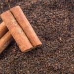 Cinnamon Stick On Dried Tea Leaves — Stock Photo #56726735