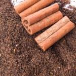 Cinnamon Stick On Dried Tea Leaves — Stock Photo #56727269