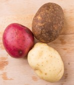 Red, Brown, Yellow Potatoes — Stock Photo