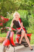 Pretty woman on a scooter thinks — Stock Photo