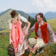 Couple flirting in the Bavarian costumes — Stock Photo #54094231