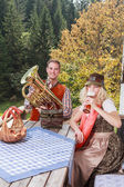 Young couple in traditional Bavarian clothes enjoy your leisure in common — Stock Photo