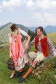 Couple flirting in the Bavarian costumes — Stock Photo